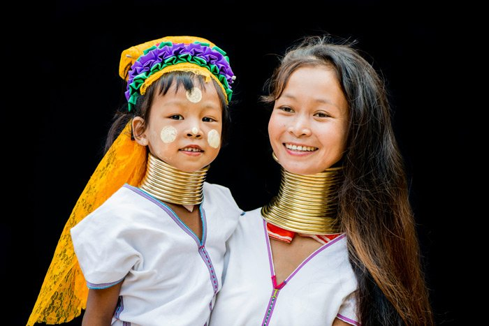 Long neck Kayan mother and daughter portrait in outdoor studio made during a custom Chiang Mai Photo Workhsop