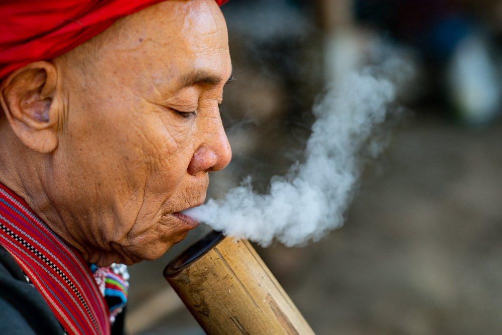 Lahu Man Smoking a bamboo bong photographed during a Chiang Mai Photo Workshop